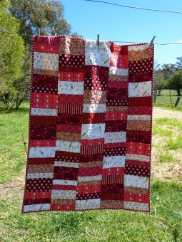 Red scrappy quilt