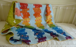 Off-set coin rainbow quilt