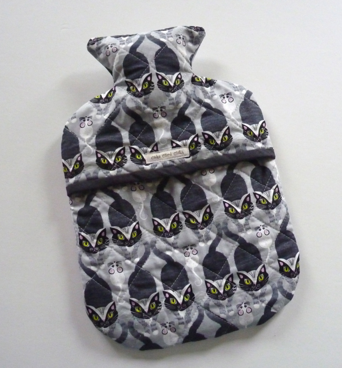Hot water bottle cover in cat and mouse fabric