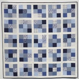 Quilt made from upcycled blue and white shirts