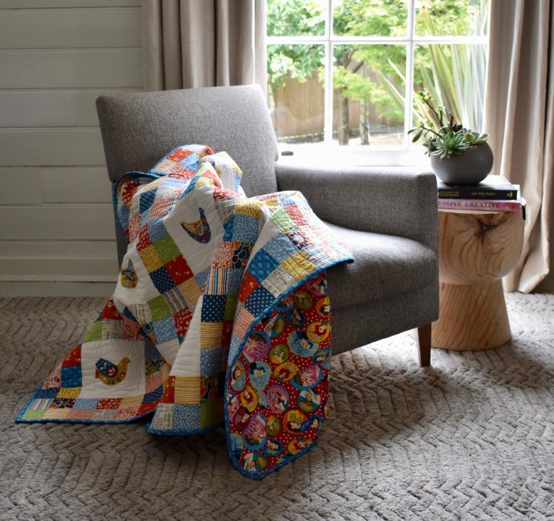 Scandi bird patchwork quilt